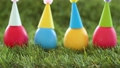 easter eggs in party caps on artificial grass 39951847