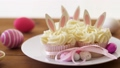 cupcakes with easter eggs and candies on table 39951854