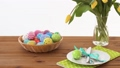 easter eggs in basket and flowers on served table 39951855