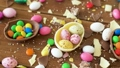 chocolate easter eggs and drop candies on table 39951856