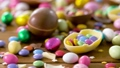 chocolate easter eggs and drop candies on table 39951857
