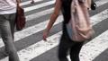 People walking in Tokyo Shibuya scramble intersection 40008504