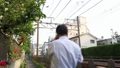 Railroad scenery Odakyu Line and office workers walking along the track 40012694