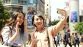 Tokyo tourist woman taking selfie with smartphone 40019922