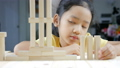 Asian little girl playing wooden brick toy 40296616