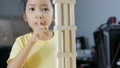 Asian little girl playing wooden brick toy 40296619