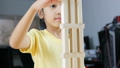 Asian little girl playing wooden brick toy 40296621