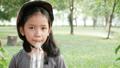 Asian little girl wearing pink helmet drinking wat 40296779