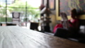 Wood table on blurred people in restaurant 40353878