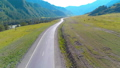 Flight over mountain asphalt highway road and meadow 40501366