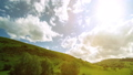 FullHD FHD mountain meadow timelapse at the summer. Clouds, trees, green grass and sun rays movement 40501933