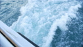 The wake of a boat as seen from the side of a ship. 40560516