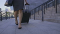 Legs of business woman walking with suitcase 40633939