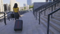 Back view asian business woman with suitcase 40633963