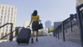 Low angle of business woman with luggage walking 40633964