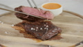 the man in the restaurant with a knife cuts steak of marble beef, grilled. Serving on a wooden Board 40651901
