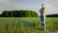 Middle-aged self-confident farmer examines his field. Full-length person. The owner of a small 40660489