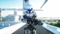 Military robot with gun walking. Futuristic city, town. Realistic FullHD animation. 40696035