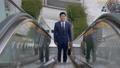 Japanese business man using outdoor escalator. 40713814