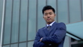 Serious Japanese business man outside office tower 40713822