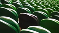 Rows of seats in a football stadium. 40718337