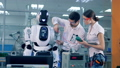 Two engineers are measuring technical parameters of a robot 40754191