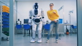 Young woman is dancing with a robot who spanks her playfully after whereafter she leaves 40754209