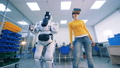 Human-like robot and a young woman in virtual glasses are dancing. 40754225