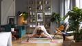 Woman does yoga in loft-studio 40818122