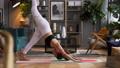 Woman does yoga in loft-studio 40848517