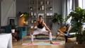 Woman does yoga in loft-studio 40848520