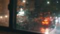Establishing shot of a busy city street corner during a storm. 41256344
