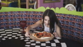Smiling girl spinning and admiring the pizza presentation in cafe. FullHD 41406214