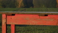 Old red wooden table  and autumn field 41456849