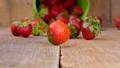Fresh strawberries falling from bucket  41502299