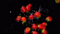 Strawberries falling on water on black background 41502309