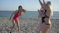 hen party on beach, group of woman in bikini sing and dance on ocean coast at vacation 41541638