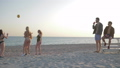 beach games, girls play volleyball in front of guys friends on seaside in summer 41541642