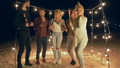 beach holiday, company of youth dancing and laughing at night party by sea 41563434