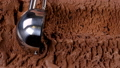 Chocolate ice cream scooped out of container 41687644