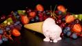 Fruit ice cream melting on black table 41703701