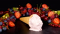 Fruit ice cream melting on black table 41703702