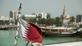 Flag of Qatar on the boat in harbour, Doha 41873257