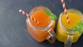 close up of fresh juices in mason jar glasses 41924522