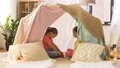 happy girls in kids tent playing tea party at home 41924534