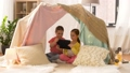 little girls with tablet pc in kids tent at home 41924535
