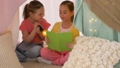 happy girls reading book in kids tent at home 41924538