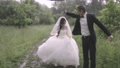 Happy and happy newlyweds with umbrella in the rain 42001795