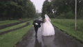 bride and groom are running in the rain 42001798