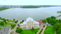 Beautiful views of the city, embankment, park, old castle and blue lake in the city center. Aerial 42025278